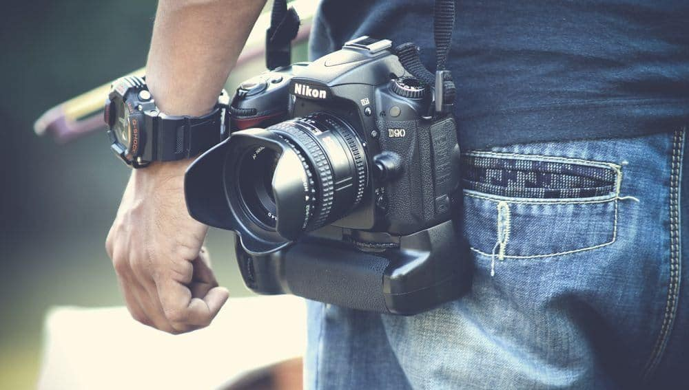 man with nikon camera