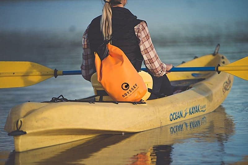 Woman kayaking with dry bag